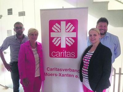 Beim Treffen von CDU und Caritas v.l. Klaus Roosen (Caritas), Marie-Luise Fasse MdL, Charlotte Quik (CDU Arbeitskreis Familie) und  Caritas-Geschäftsführer Henric Peeters.
